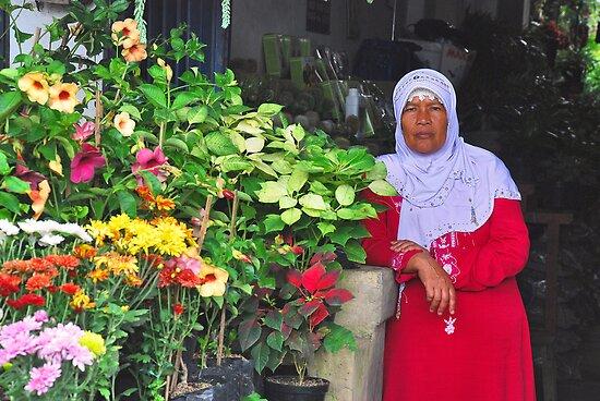 Balinese flower seller by Adri  Padmos
