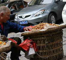 Chinese street vendor in Chongqing by Daniel Murley