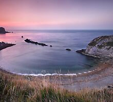 dawn over Man-o-War bay. Dorset by outwest photography.co.uk