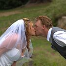 Rachie & Shawn Kissing the bride by Rosemaree