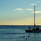A sail boat, surfers and the sunset by kekipi