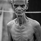 man in Tirupur shantitown by Loic Dromard