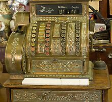 Cash register by Anna D'Accione