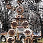Hub Cap Man by Susan Russell