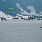 Kiteboarder on a frozen Swiss Alpine lake by Michael Brewer
