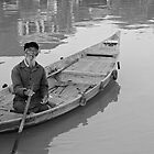 Lone Boatman - Hoi An, Vietnam  by Odalisque