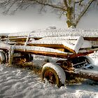 Old Cart In The Snow By A Tree by Eddie Howland