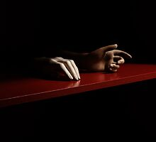 Spare hands on a red-painted shelf by wingpig