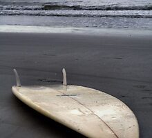 The Lone Surfboard by Intheraine