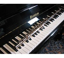Flute on Piano Keyboard Photographic Print