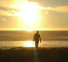 A surfer at sunset, Pacific Beach CA by rkdownton
