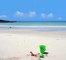 Beach Toys abandoned on a secluded beach by Deb22