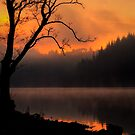 Mist and Fire... Sunrise on Loch Ard by David Mould
