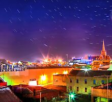 Star Trails Over The City by Christopher M Tsorotes