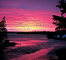 Flaming Sunset on the Lighthouse route by Roxane Bay
