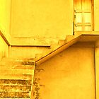 Take the yellow stairs up and it's the yellow door on your left...you can't miss it!  by Valerie Rosen
