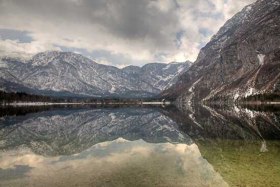 Reflections of an Alpine lake by Ian Middleton