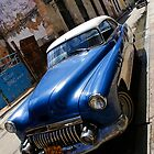 Classic car, run down area, Havana by buttonpresser