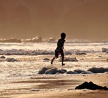 Golden Boy Beach Runner by Neil  Bradfield