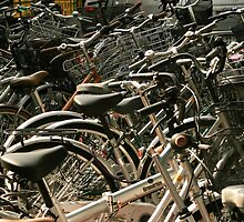 Bikes on the street, Tokyo, Japan by Brad Starks