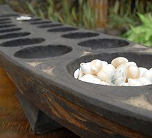 sungka, a Philippine mancala game by walterericsy