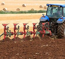 Tractor ploughing panoramic by buttonpresser