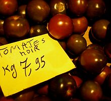 Black Tomatoes in a Parisian market by Britland Tracy