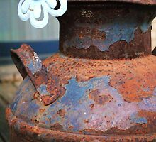 Metal flower atop an antique milk can by lofquist