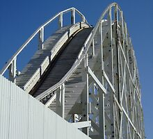 Old Rickety Roller Coaster Ride with Blue Sky by kaevhe
