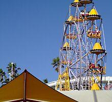 Yellow Ferris Wheel Against Blue Sky by kaevhe