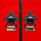 Iron Door Handles Against A Red Church Door by Jennifer Hulbert-Hortman