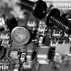 Circuit Board and Screws (B&W) by Derek McMorrine