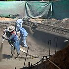 Shooting gunite to form a swimming pool by Ann Reece