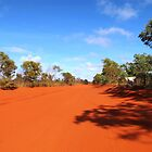 Long, red, bumpy & dusty road by dozzam