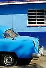 Blue Dodge with punctured tyre, Callejon De Hamel, Havana, Cuba by buttonpresser
