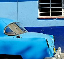 Blue Dodge with punctured tyre, Callejon De Hamel, Havana, Cuba by buttonpresser