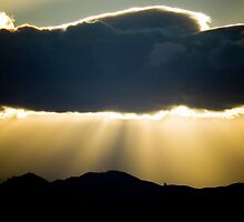Rays of Light streaming down on Hill Tops by trevallyphotos