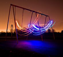 Playing on the Swings by Nick Acott