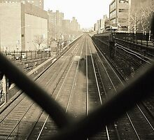 train tracks through chain link fence by ShellyKay