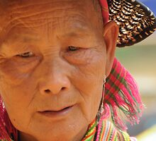 Flower Hmong woman by Judi Corrigan