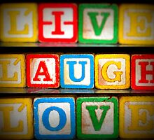 Live Laugh Love in old wooden blocks by Patricia Cleveland