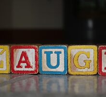 Laugh in old wooden blocks by Patricia Cleveland