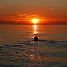 Sunset swim by Trine