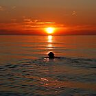 Sunset swim by Trine