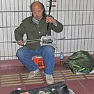 Erhu player, Beijing Metro, China by Philip Mitchell