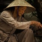 Vietnamese woman preparing a cigarette by Gordito73