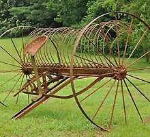rusty hay rake by A.R. Williams