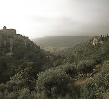 Summer storm clouds over Gordes, Provence by Christopher Barton