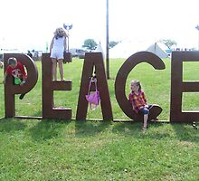 Children give peace a chance. - sunrise festival by Megan Mansell