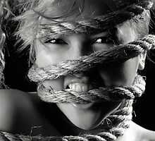 Ropes around beautiful young woman face by ArtNudePhotos
